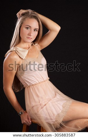 Pretty woman sitting and looking thoughtful - stock photo