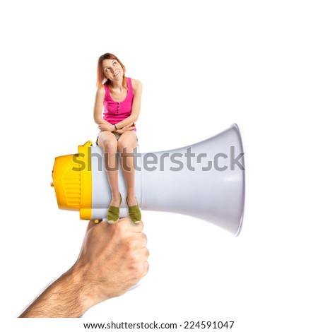 pretty woman sitting on megaphone - stock photo