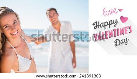 Pretty woman smiling at camera with boyfriend holding her hand against cute valentines message - stock photo