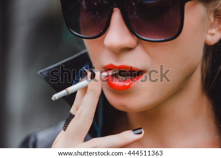 pretty woman smoke cigarette, fashion model, outdoor close up portrait, lips red, sunglasses hipster, skin - stock photo