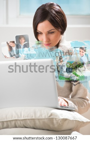 Pretty woman surfing on web with modern laptop - stock photo
