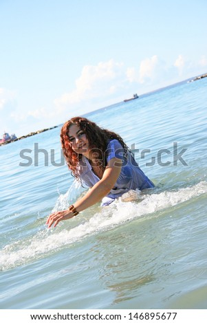 Pretty woman swimming in the sea. - stock photo