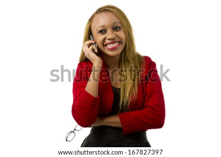 Pretty woman talking on her phone smiling - stock photo