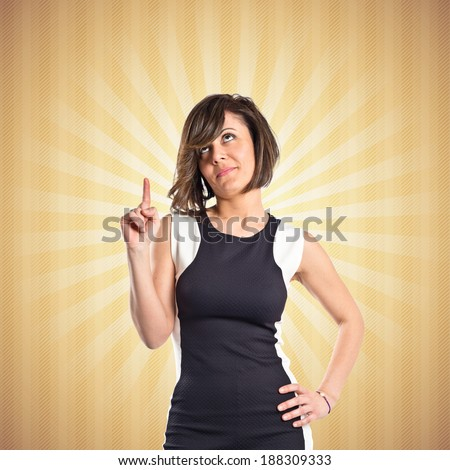 Pretty woman thinking over pop background  - stock photo