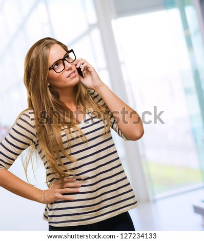 Pretty Woman Using Cell Phone, indoor - stock photo