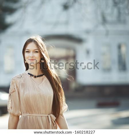 Pretty woman  walking street. - stock photo