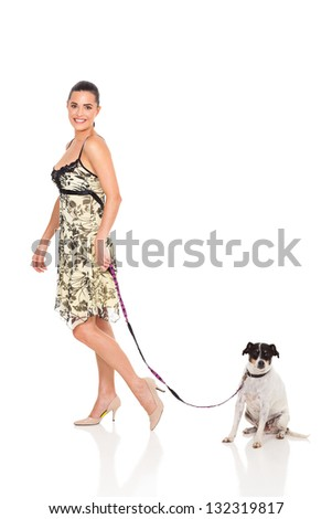 pretty woman walking with dog isolated on white - stock photo