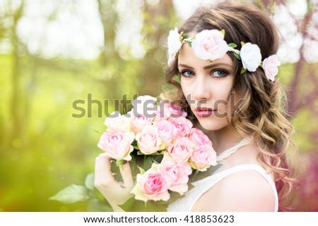 pretty woman with a bouquet roses / Woman with roses - stock photo