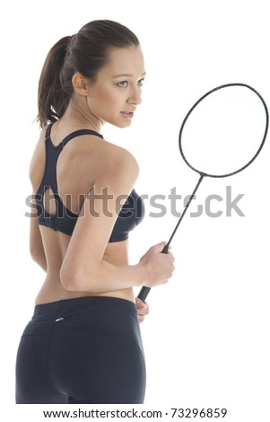 Pretty woman with badminton racket - stock photo