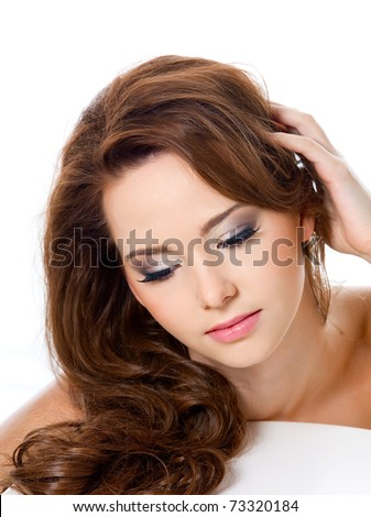 pretty woman with beauty hairs and glamour makeup - isolated - stock photo