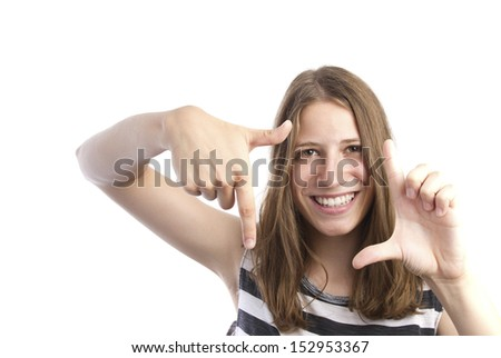 pretty woman with hands frame - stock photo