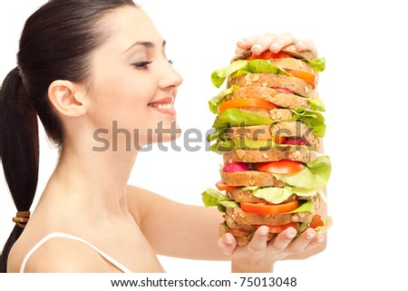 pretty woman with huge healthy sandwich, smiling, isolated on white - stock photo