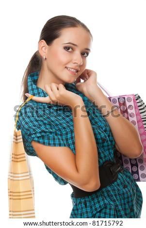pretty woman with shopping bags isolated on white background - stock photo