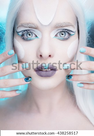 pretty woman with snow queen frosted makeup and light blue gel nails - stock photo