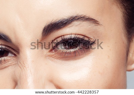 Pretty womans eye close up. beautiful brunette girl with no makeup, natural makeup - stock photo
