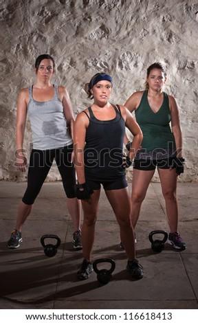 Pretty women pausing during a sweaty workout - stock photo