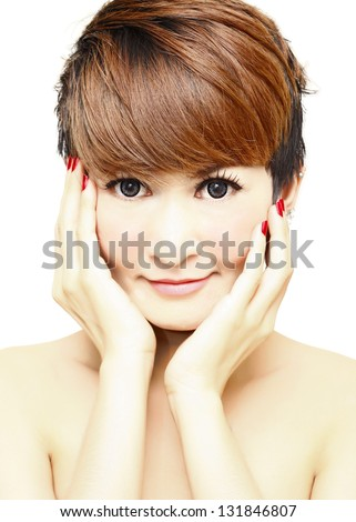 Pretty women short hair touching her Face and smiling. - stock photo