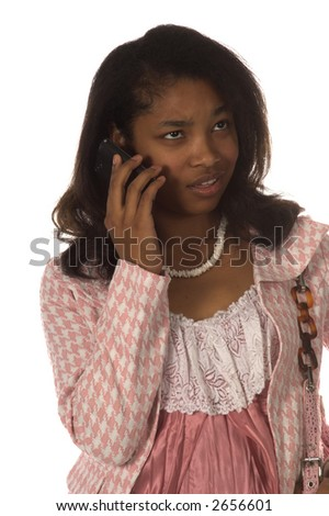 Pretty young African American woman dressed in a pink herringbone business suit talking on a cell phone with a upset expression on her face - stock photo