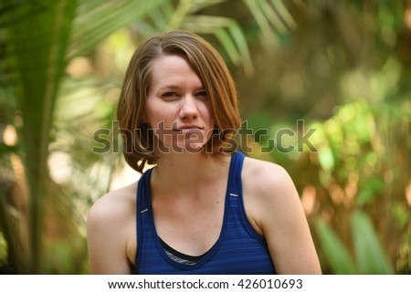 Pretty, young and angry woman with scowl on face - stock photo