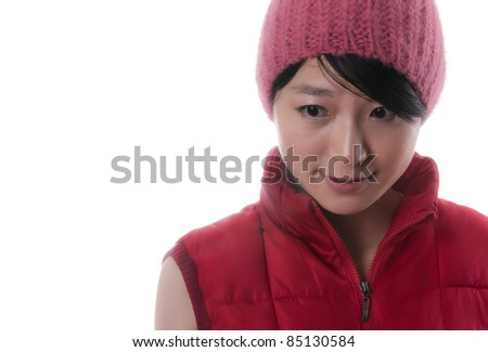 Pretty young asian woman with a red winter jacket and a nice red cap - stock photo