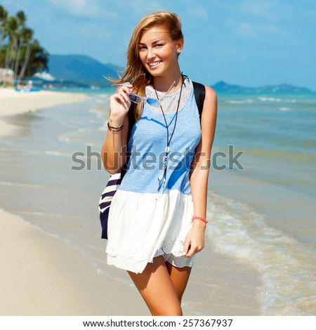 Pretty young beautiful sensual blonde woman posing on the beach and have fun alone near blue sea and sky smiling happy face  - stock photo