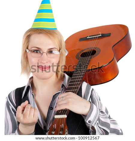 pretty young blond business woman in the birthday cap with the guitar - stock photo