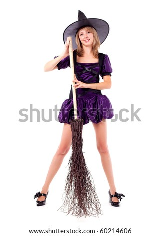 pretty young blond woman dressed as a witch with a broom - stock photo