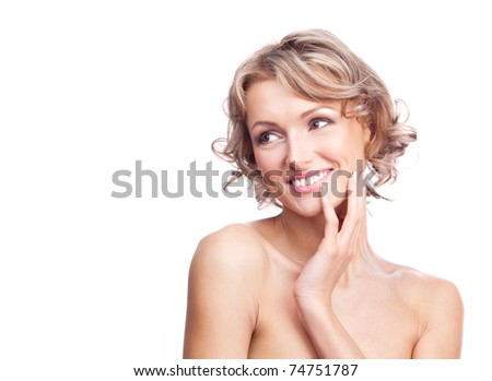 pretty young blond woman with curly hair,touching her cheek and looking to the left - stock photo