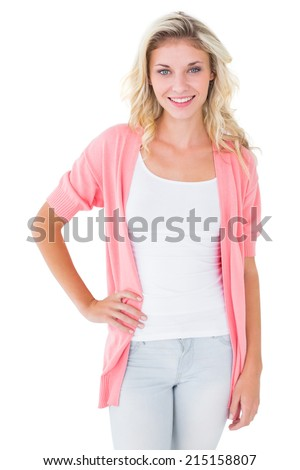Pretty young blonde smiling at camera on white background - stock photo