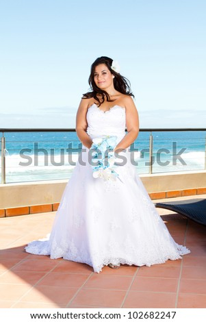 pretty young bride with bouquet - stock photo