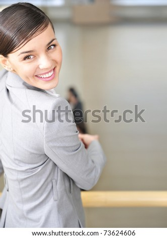 Pretty young business woman leaning on a railing - Copyspace - stock photo
