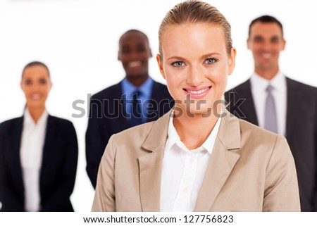 pretty young businesswoman in front of colleagues - stock photo
