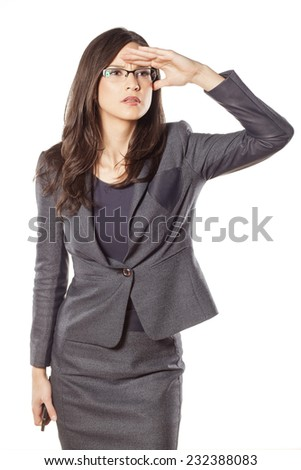 pretty young businesswoman looking into the distance - stock photo