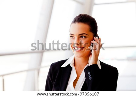 pretty young businesswoman talking on cell phone - stock photo