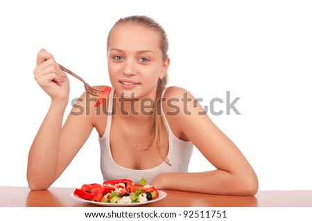 pretty young caucasian woman eat vegetable salad, young healthy fitness woman on diet and eat vegetarian salad, woman eating salad,isolated on white background image - stock photo