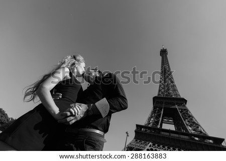 pretty young enamoured and beauty caucasian couple in Paris - stock photo