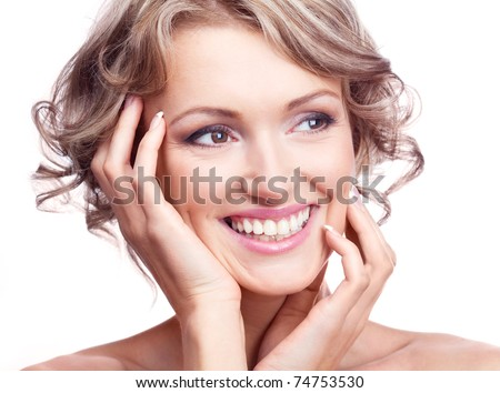 pretty young excited woman with curly hair, looking to the right - stock photo