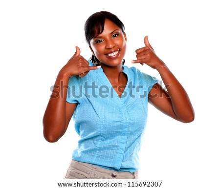 Pretty young female looking at you saying call me against white background - stock photo