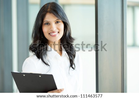 pretty young female office worker portrait - stock photo