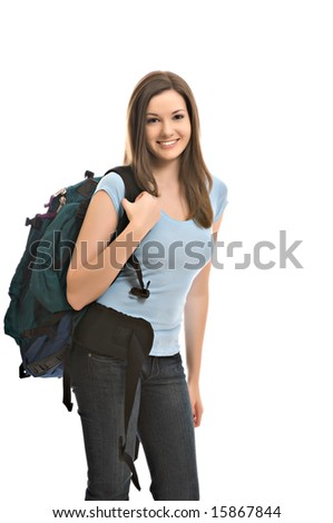 Pretty young female student carries backpack - stock photo