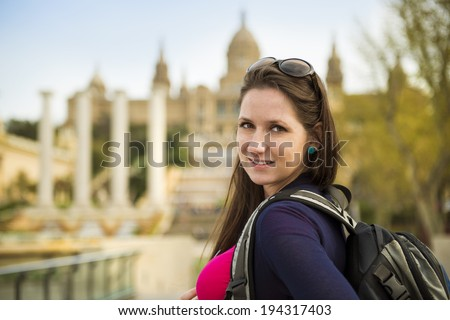 Pretty young female tourist is enjoying the view in Barcelona, Spain. - stock photo
