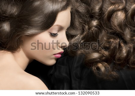 pretty young girl brunette in sweet portrait with hairstyle and curly hair - stock photo
