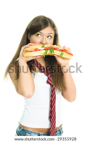 pretty young girl eating a huge sandwich, isolated against white background - stock photo