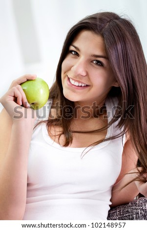 pretty young girl holding an green apple, healthy eating - stock photo
