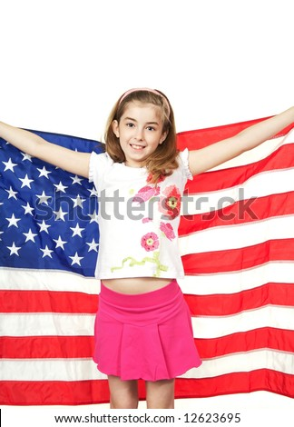 Pretty young girl holding the American Flag - stock photo