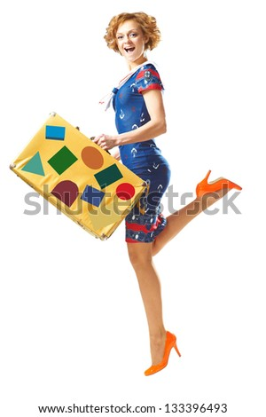 Pretty young girl in a jump with vintage suitcase in hand over white background - stock photo