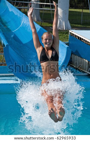 Pretty young girl joy in the water slides - stock photo