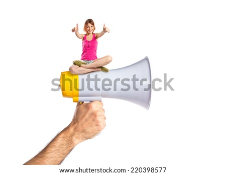 Pretty young girl on megaphone over white background - stock photo