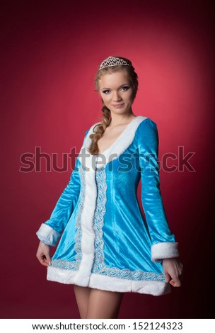 Pretty young girl posing in suit of Snow Maiden - stock photo