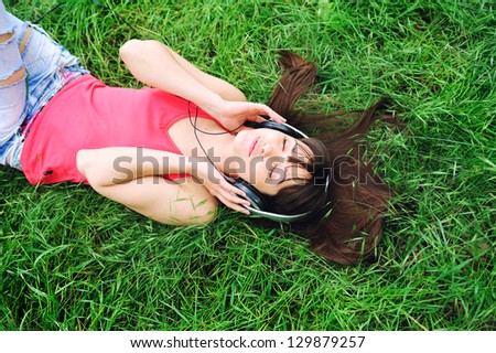 Pretty young girl relax listening music. - stock photo
